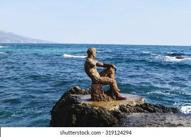 Black sea coast of Crimea,  view 'Alyosha' - vintage sculpture of man looketh upon sea on Foros pier