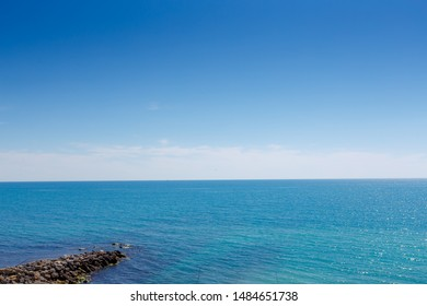 Black Sea. Stones in the foreground. Clear day, calm, good weather. Background