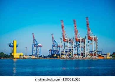 Black Sea trade port, containers loading by crane. International marine shipping. Container import export logistic, cargo harbor view, water transport. Industrial freight. Seaport cranes panorama.