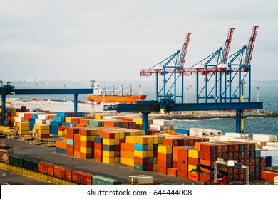 Black Sea trade port, cranes loading containers. International marine shipping. Container import export logistic, cargo harbor view, water transport. Industrial freight. Seaport cranes panorama.