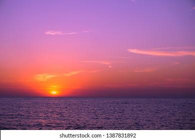 Black sea under violet purple sky. Sunset time today, useful background.