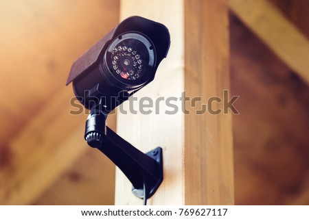 black security surveillance camera