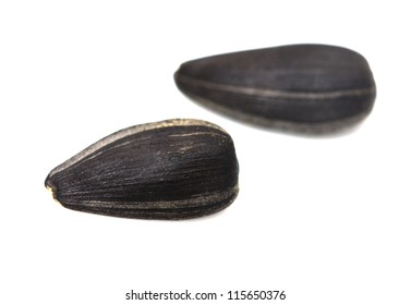 black seeds on a white background. macro
