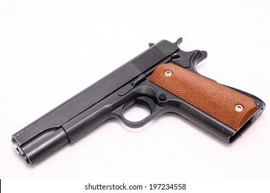 Black semi automatic Handgun on white background