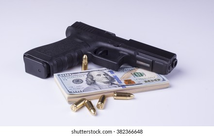 Black semi-automatic gun with american dollars and projectiles