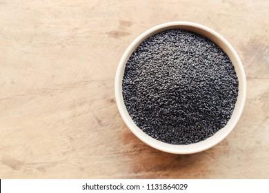 Black Sesame close up shot on wood background