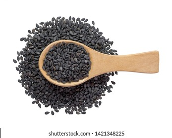 Black sesame seeds in wooden spoon pile and spread isolated on white background.Scientific name is Sesamum orientale L.Herb.cereal, Top view.