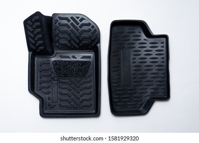 black set of mats for car made of thermoplastic elastomer on a white background