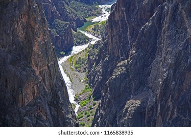 Black Shadow copy space in Black Canyon of the Gunnison National Park and recreation area at Painted Wall view, near Montrose, Colorado, USA with the Gunnison River flowing through it.