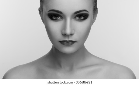 Black shadows on the eyes, smoky eyes, Women Makeup Beauty in studio, black and white photography