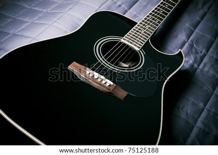Black Shiny Acoustic Guitar On Bed Stock Photo Edit Now 75125188