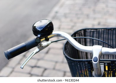 Black shiny bicycle bell and front basket