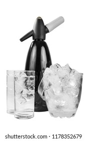 Black shiny metal table siphon for soda, next to a transparent bucket of ice and two glasses of mineral sparkling water, isolated white background, side view, for a menu of restaurants, bars, cafes