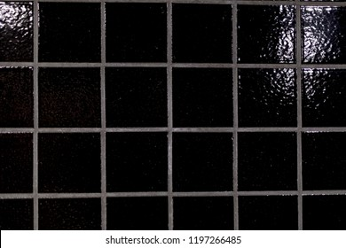 Black shiny tiles in closeup. Subway, Stockholm