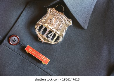 Black shirt and police badge represent occupation uniform and security concept related idea.