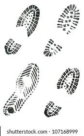 Black shoe prints on white background