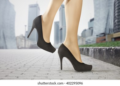 black shoes and slim legs and city