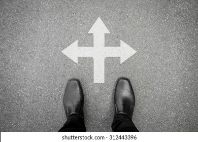 black shoes standing at the crossroad - three way to go or back