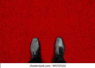 black shoes standing on red carpet floor - begin his success and fame