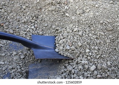 black shovel and gravel