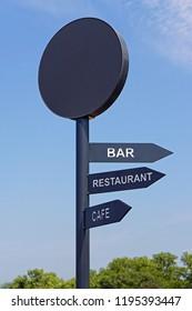 Black sign post for bar restaurant and cafe direction