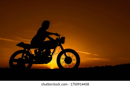 Black silhouette of a girl on a retro custom bike. Motorcycle and girl on a background of sunset over the evening.