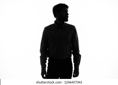 black silhouette of a man on a light background
