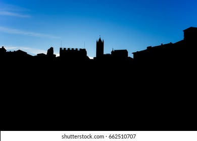 Black silhouette of the palaces of a city with the background of the blue sky.