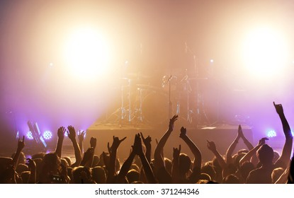 Black silhouette of people on rock concert