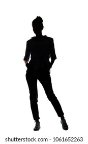 Black silhouette of a woman dressed in jeans, shirt and sneakers - isolated photo of a woman
