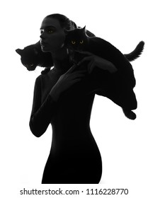 Black silhouette of woman with two cats on shoulders isolated on white background