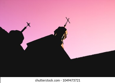 Black silhouette of wooden Church with domes and crosses on red and purple clear sky background, concept of the coming of the end of World the doomsday and the Last Judgment