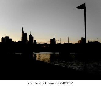 Black silhouettes of Frankfurt skyscrapers. Cityscape in twilight at sunset. Germany. Europe