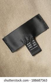 Black silk label on beige velvet cloth