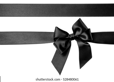 Black silk ribbons and bow isolated on the white background