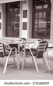 Black and Silver Cafe Terrace Table and Chairs in Black and White Sepia Tone