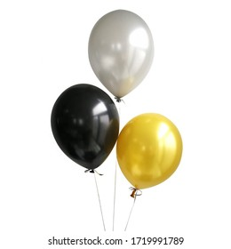 black, silver, gold balloons on white background