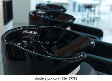 black sink for washing the hair in a beauty salon