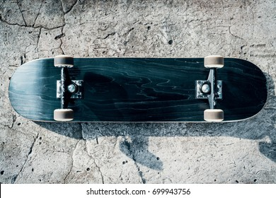 Black skateboard isolated on a concrete background in skate park