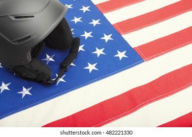 Black ski helmet over US flag as symbol of active life style