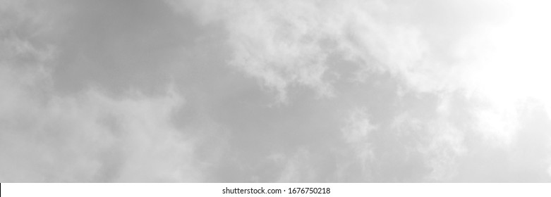 Black sky with white cloud. Dark background.