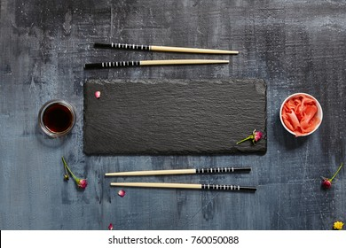 Black Slate Plate with Chopstick on Dark Background. Flat Lay. Food Concept