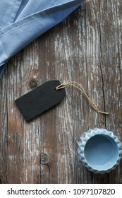 black slate sign mockup with cup and linen