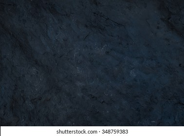 Black slate stone texture. Natural surface, background and wallpaper