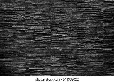 black slate stone from water feature wall  texture background
