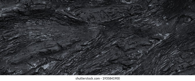 Black slate texture. Uneven rough surface, height differences. Top view