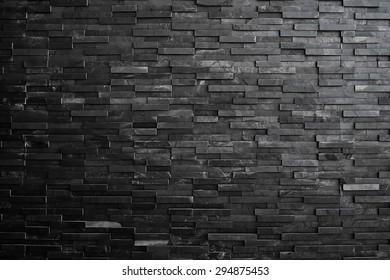 Black slate wall texture and background.