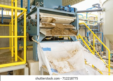 Black sludge disposal from wastewater treatment in white plastic bag