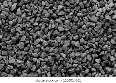Black small road stone background,  dark gravel pebbles stone texture seamless texture, granite,marble