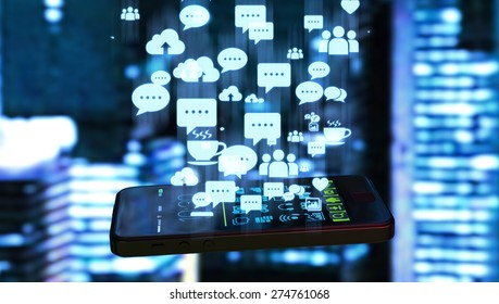 Black smart phone emitting holographic image of social media related icons and blurred night city background.